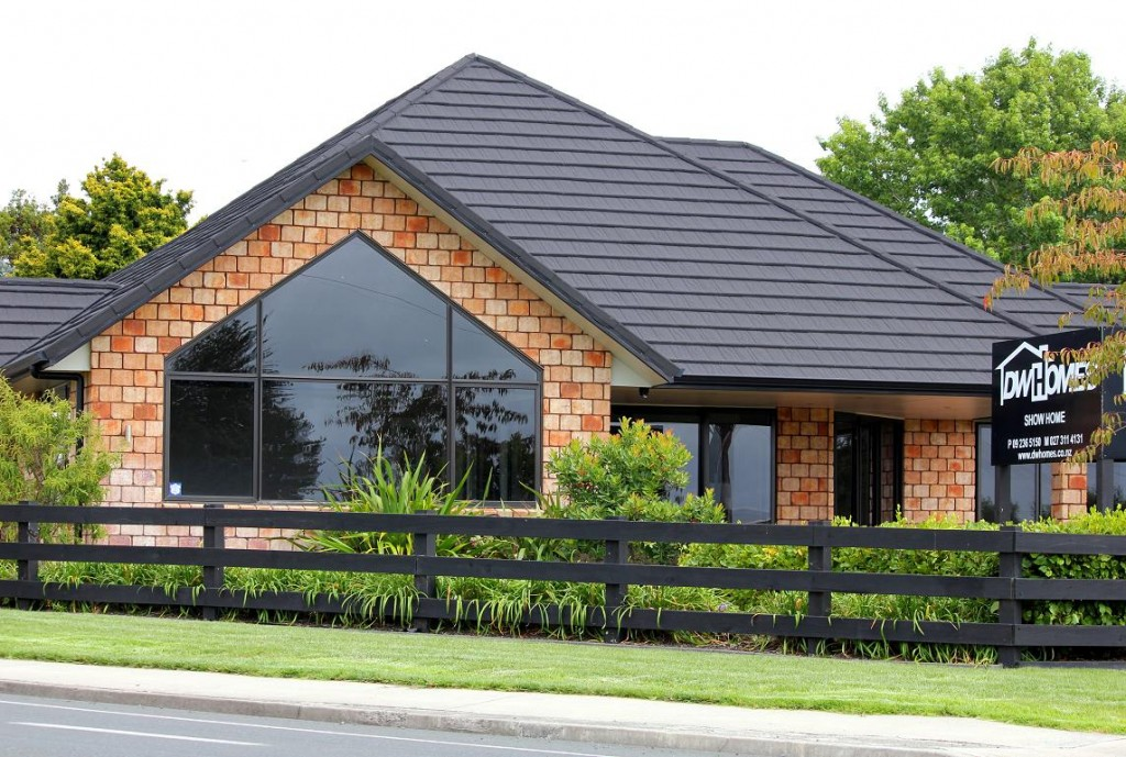 a house with metal sheets on its roof